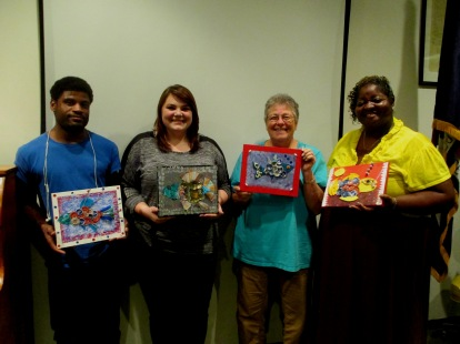 Some of the staff with their artwork